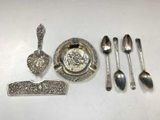 Three pieces of Dutch embossed silver and four Georgian silver teaspoons 4.6oz