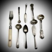 A pair of Victorian silver salt spoons, three other spoons two butterknives and a fork
