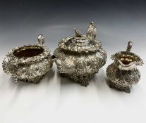 A remarkably ornate Irish tea service by R W Smith, Dublin 1837, the teapot with bunch of grapes