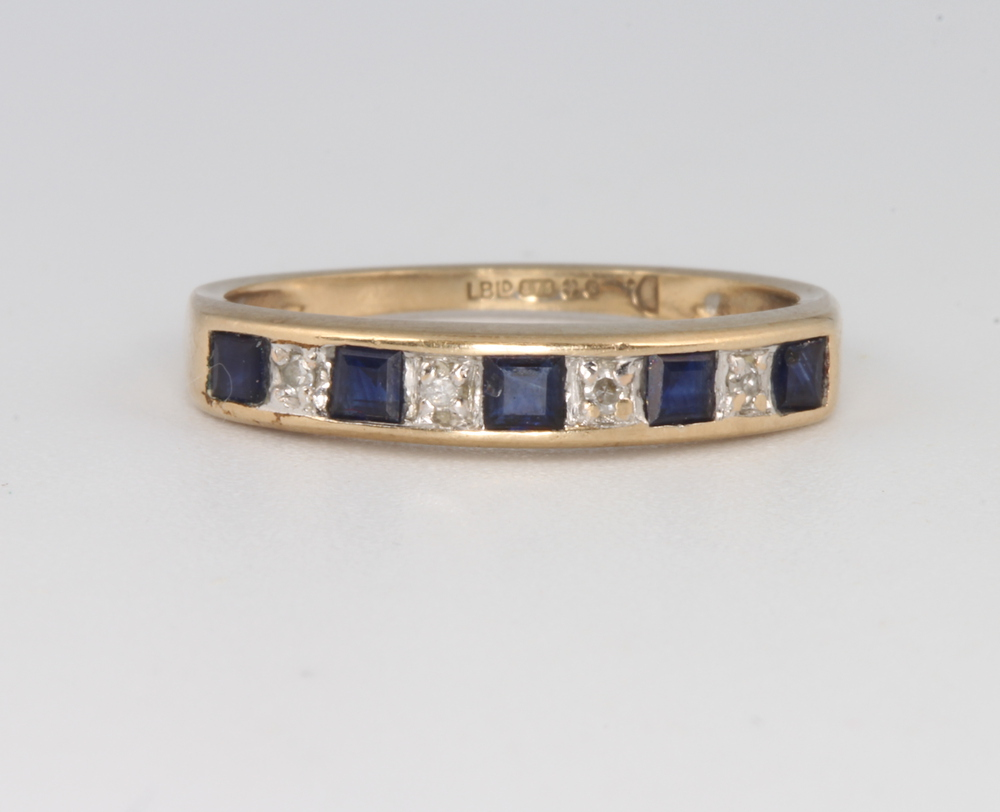 Lot 564 - A 9ct yellow gold sapphire and diamond half eternity ring, size L 1/2, 1.6 grams