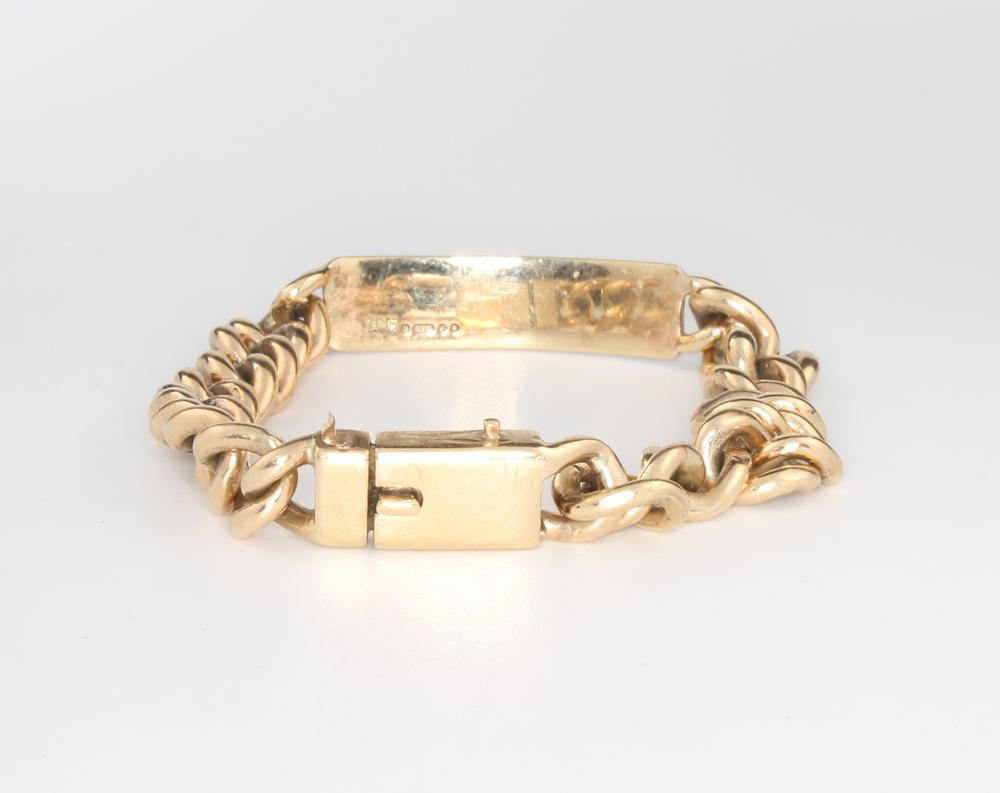Lot 565 - A 9ct yellow gold identity bracelet 30.4 grams