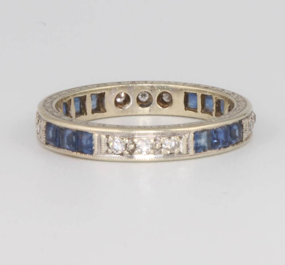 Lot 670 - A 9ct white gold sapphire and diamond eternity ring size M 1/2, 3 grams