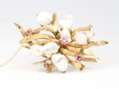 A 14ct yellow gold baroque pearl and ruby open scroll brooch 16.8 grams, 55mm x 35mm