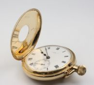 Of Railway Interest. A gentleman's 18ct yellow gold half hunter pocket watch with enamelled front
