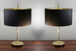 A PAIR OF GILT TABLE LAMPS, 71cm high.