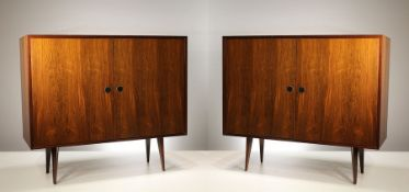 A PAIR OF ROSEWOOD SIDE CABINETS, ITALIAN 1960's BY VITTORIO DASSI, with a pair of panel doors,