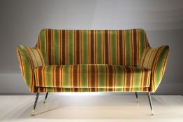 AN UPHOLSTERED TWO SEAT SOFA, ITALIAN 1960s, on splayed metal legs with brass feet, 143cm (w) x 85cm
