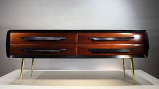 A FINE ROSEWOOD SIDE CABINET, ITALIAN 1960s, with shaped sides, comprising four drawers, raised on