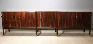 A ROSEWOOD MODULAR SIDEBOARD, ITALIAN 1960s BY VITTORIO DASSI, comprising a pair of cabinets, each