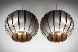 A PAIR OF METAL PENDANT LIGHTS, IN THE MANNER OF LOUIS WEISDORFF, 90cm high x 40cm (diam).