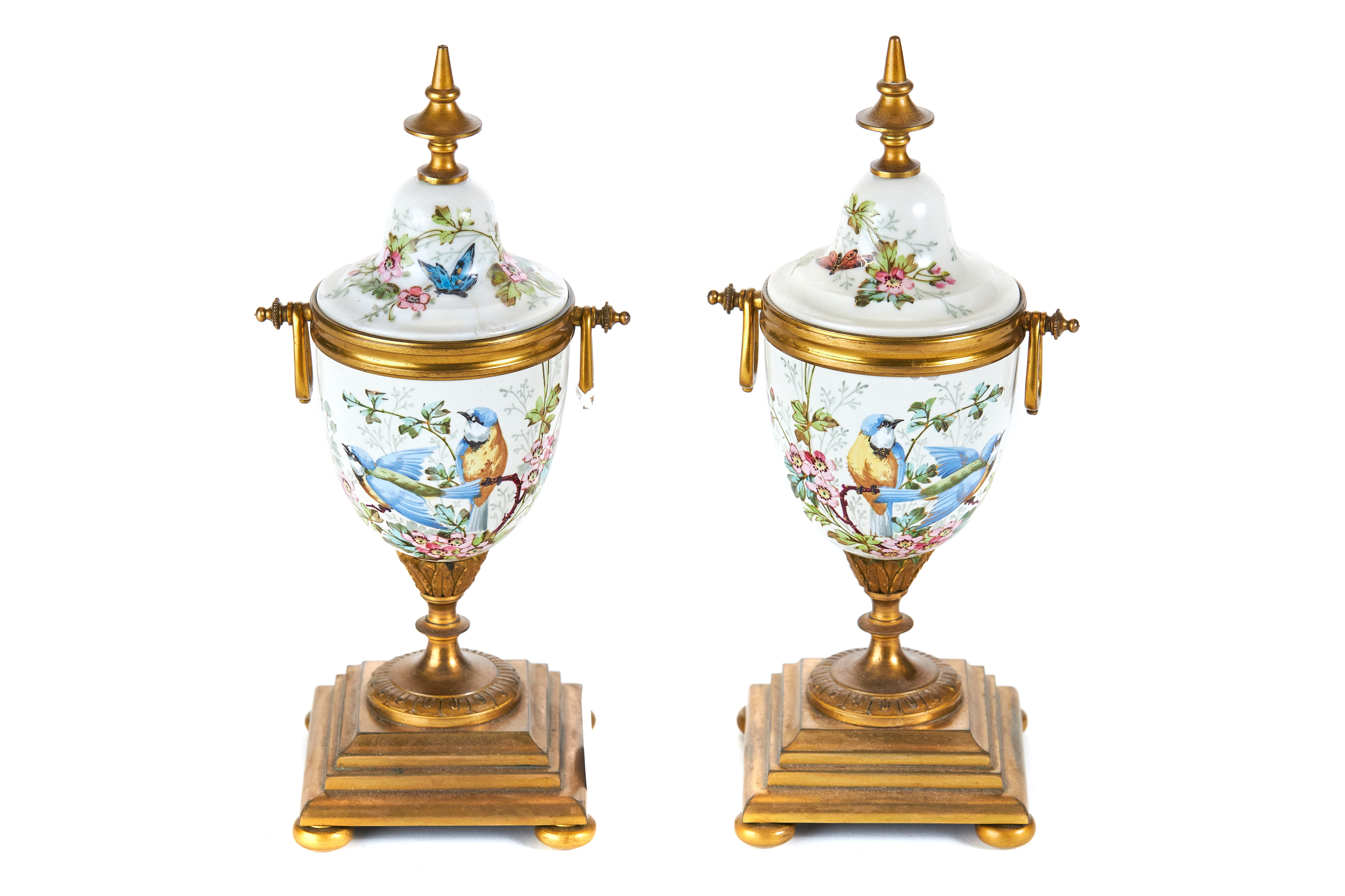 Lot 31 - A PAIR OF LATE 19TH CENTURY CONTINENTAL PORCELAIN AND ORMOLU MOUNTED URNS polychrome decorated with