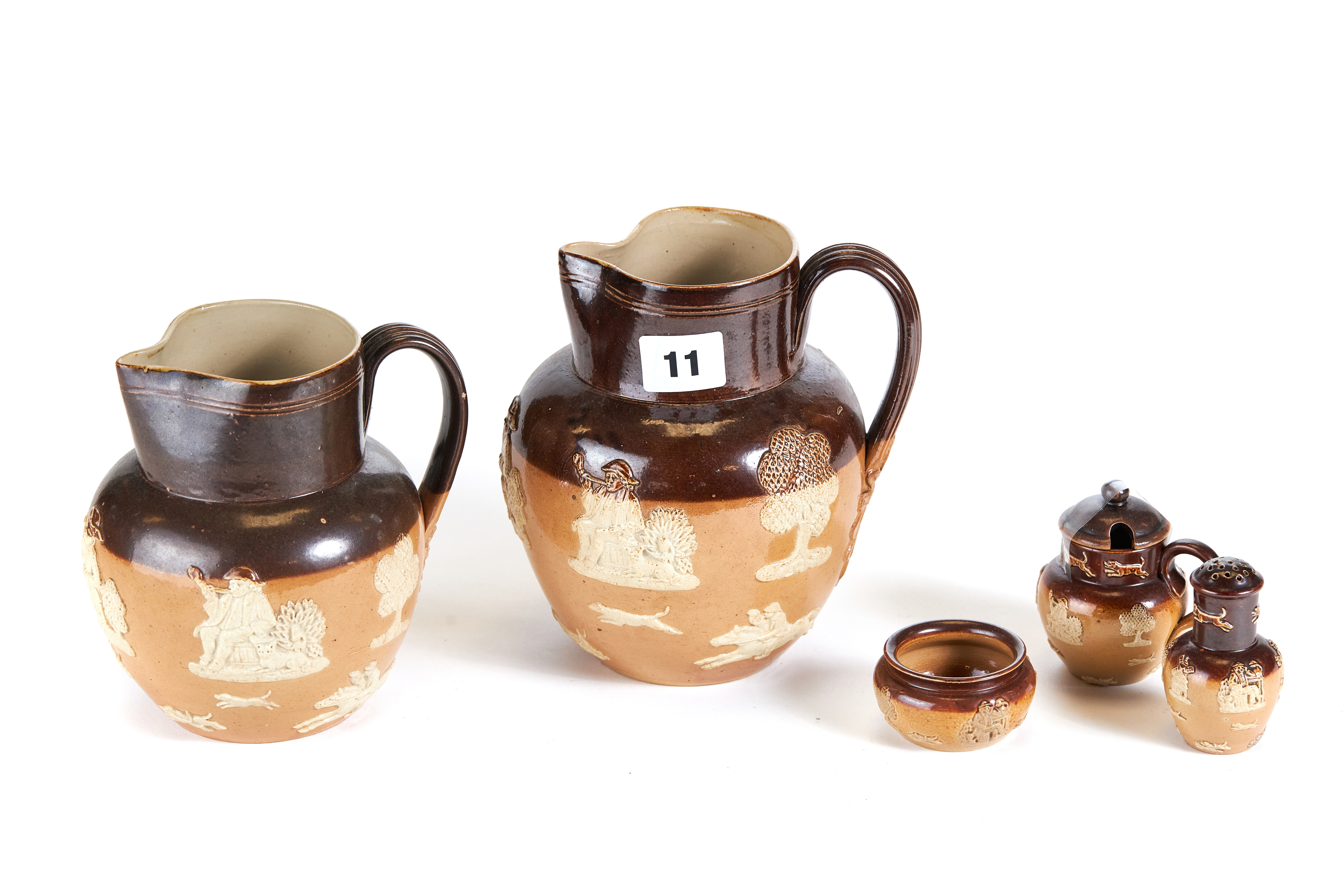 Lot 11 - A LATE 19TH CENTURY LAMBETH DOULTON STONEWARE THREE PIECE CONDIMENT SET with toper and hound