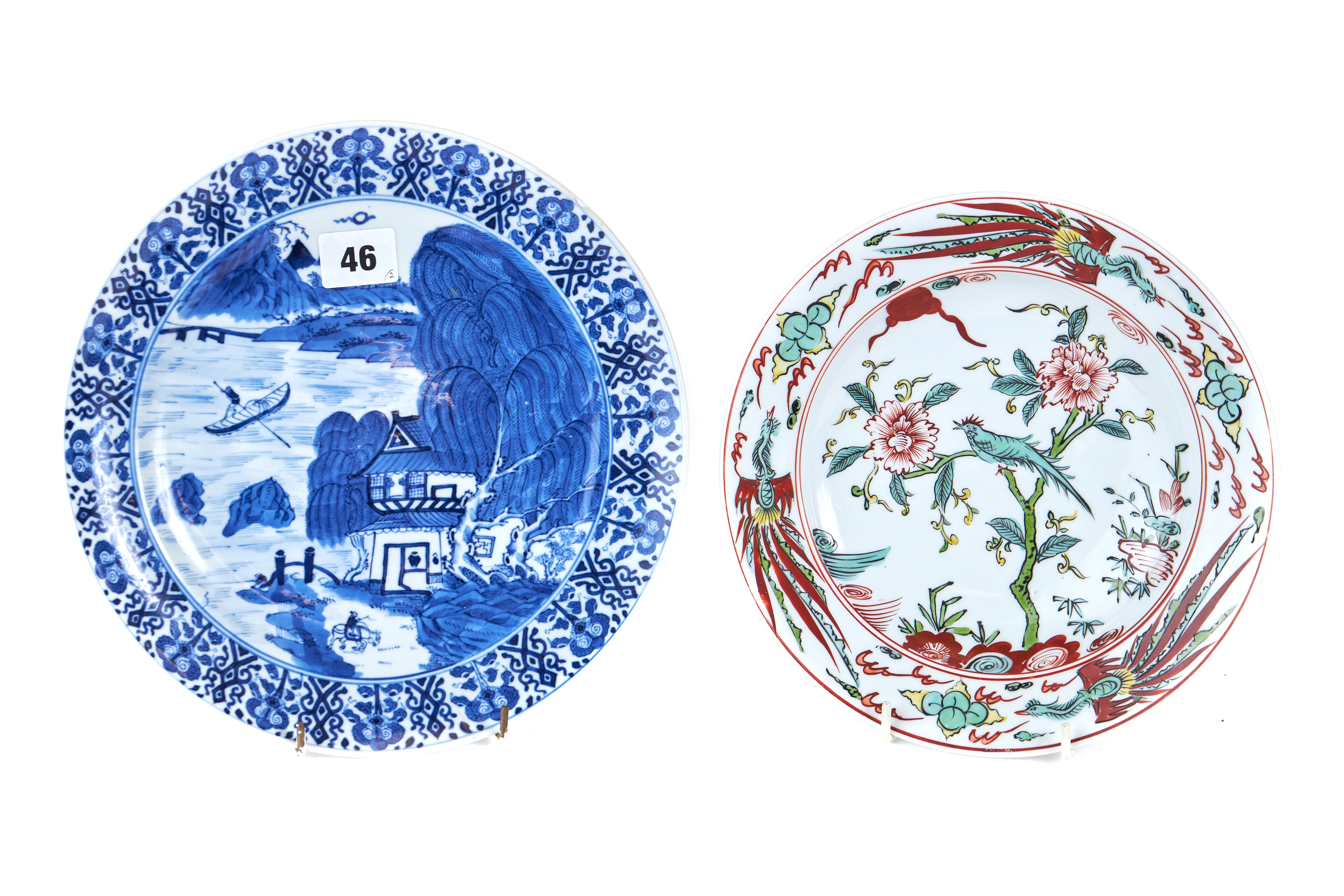 AN UNUSUAL 19TH CENTURY CHINESE UNDERGLAZE BLUE PAINTED PLATE decorated with a riverside landscape,