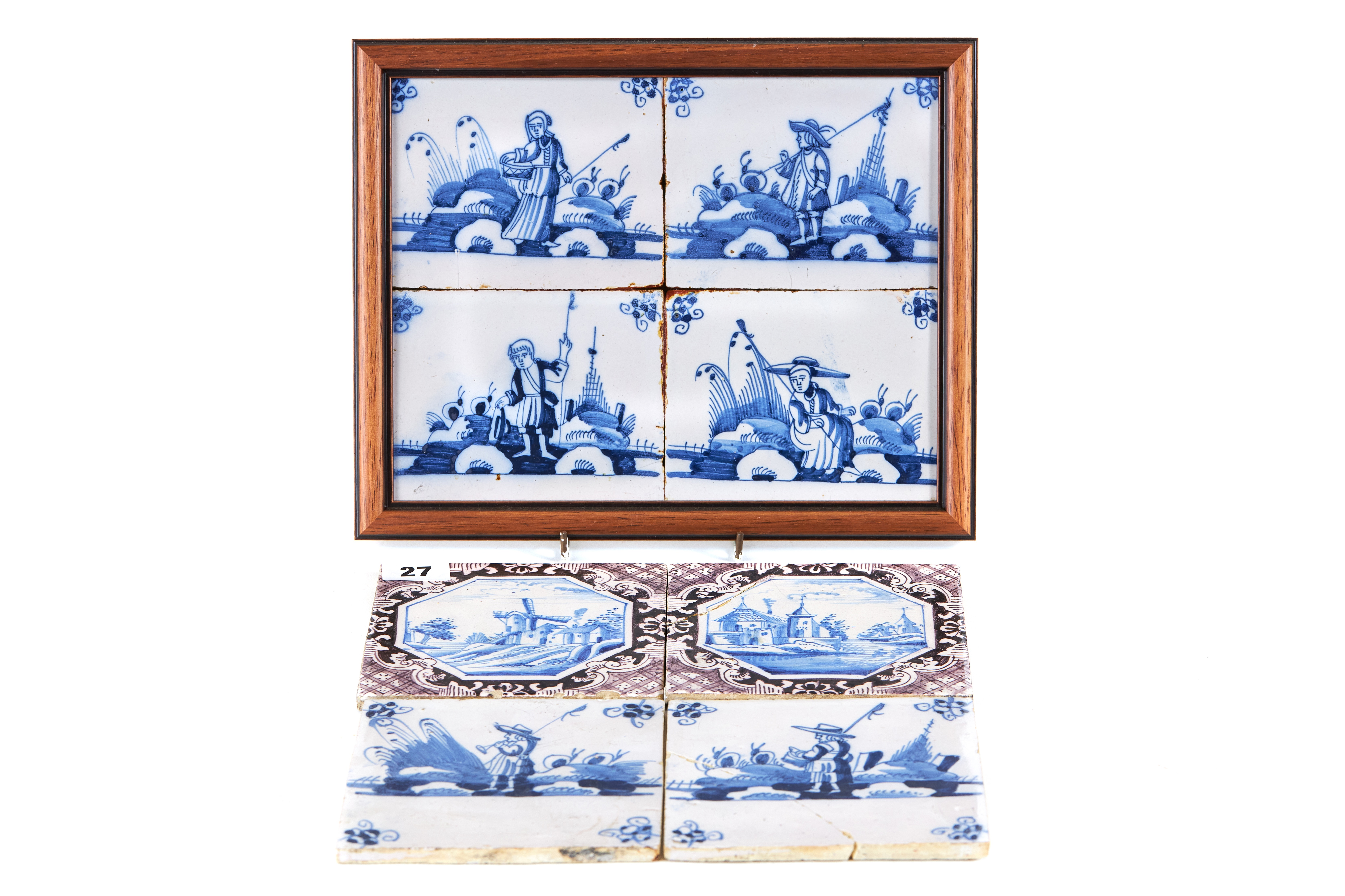 Lot 27 - A PAIR OF 18TH CENTURY BLUE AND WHITE TILES with scenic centres and manganese borders, one a.