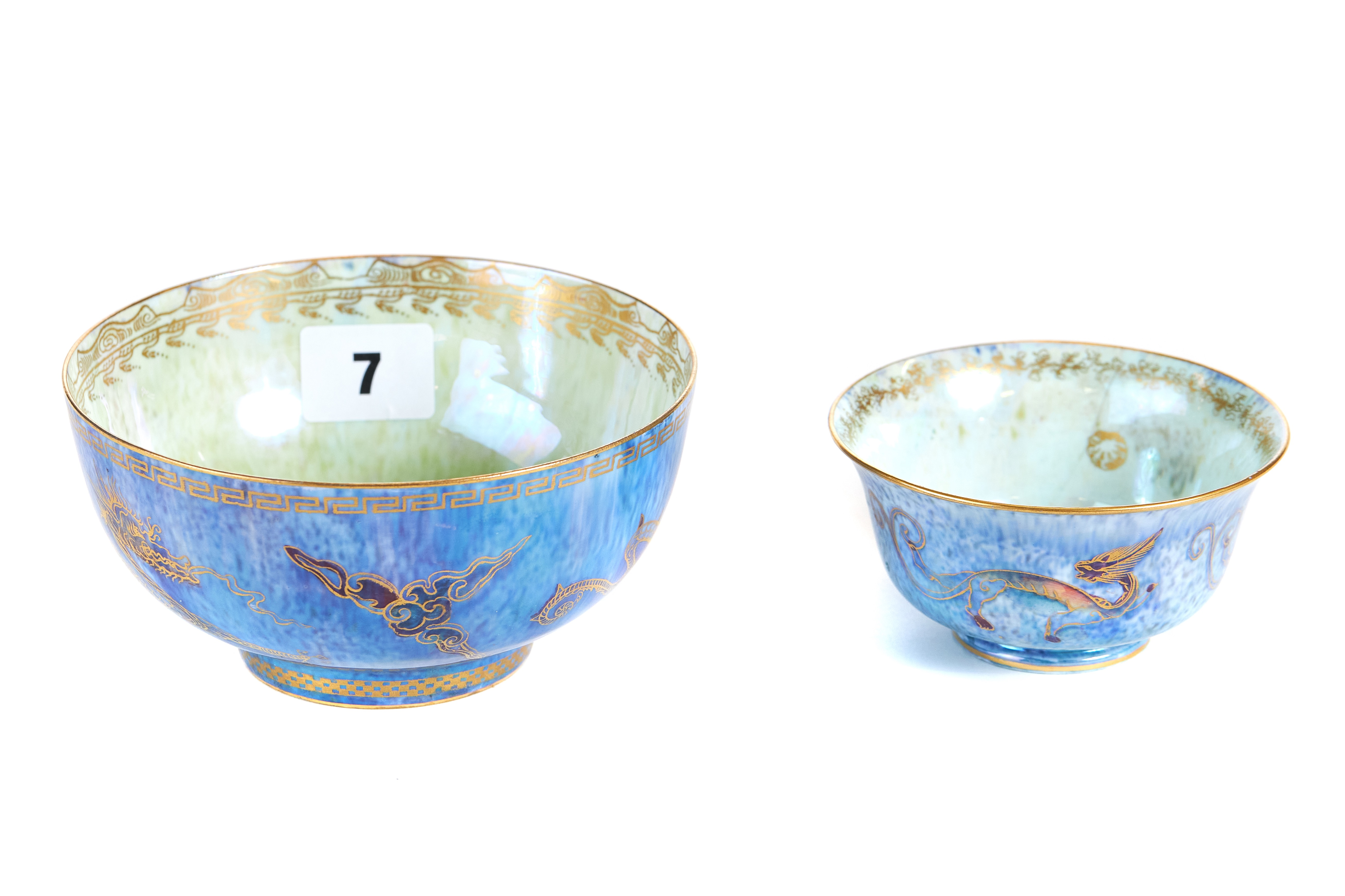 Lot 7 - AN EARLY 20TH CENTURY WEDGWOOD LUSTRE WARE CIRCULAR BOWL external blue ground with gilt dragons and