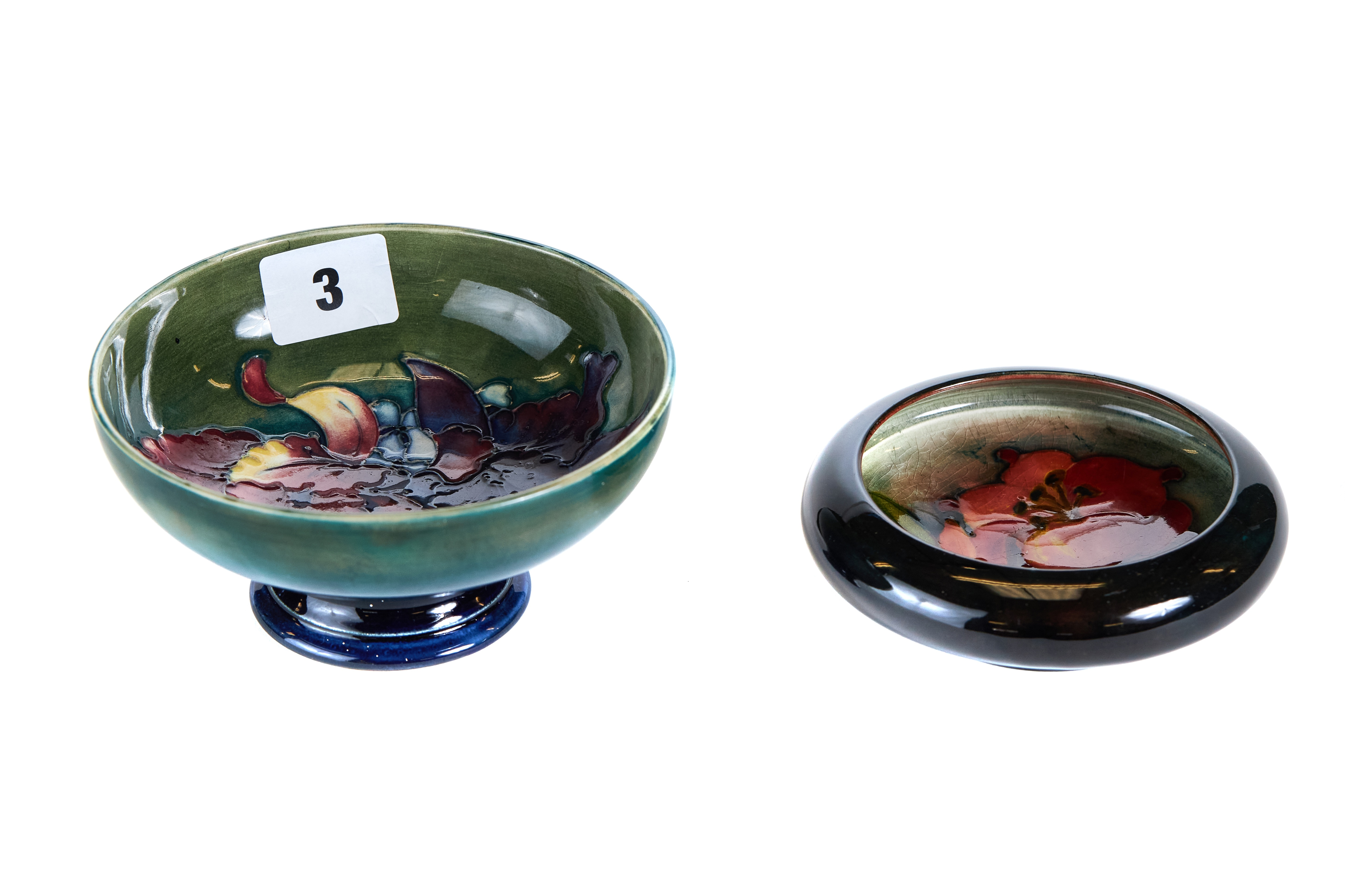 Lot 3 - A 20TH CENTURY MOORCROFT POTTERY GREEN GLAZED PEDESTAL BOWL internally decorated with flowers,