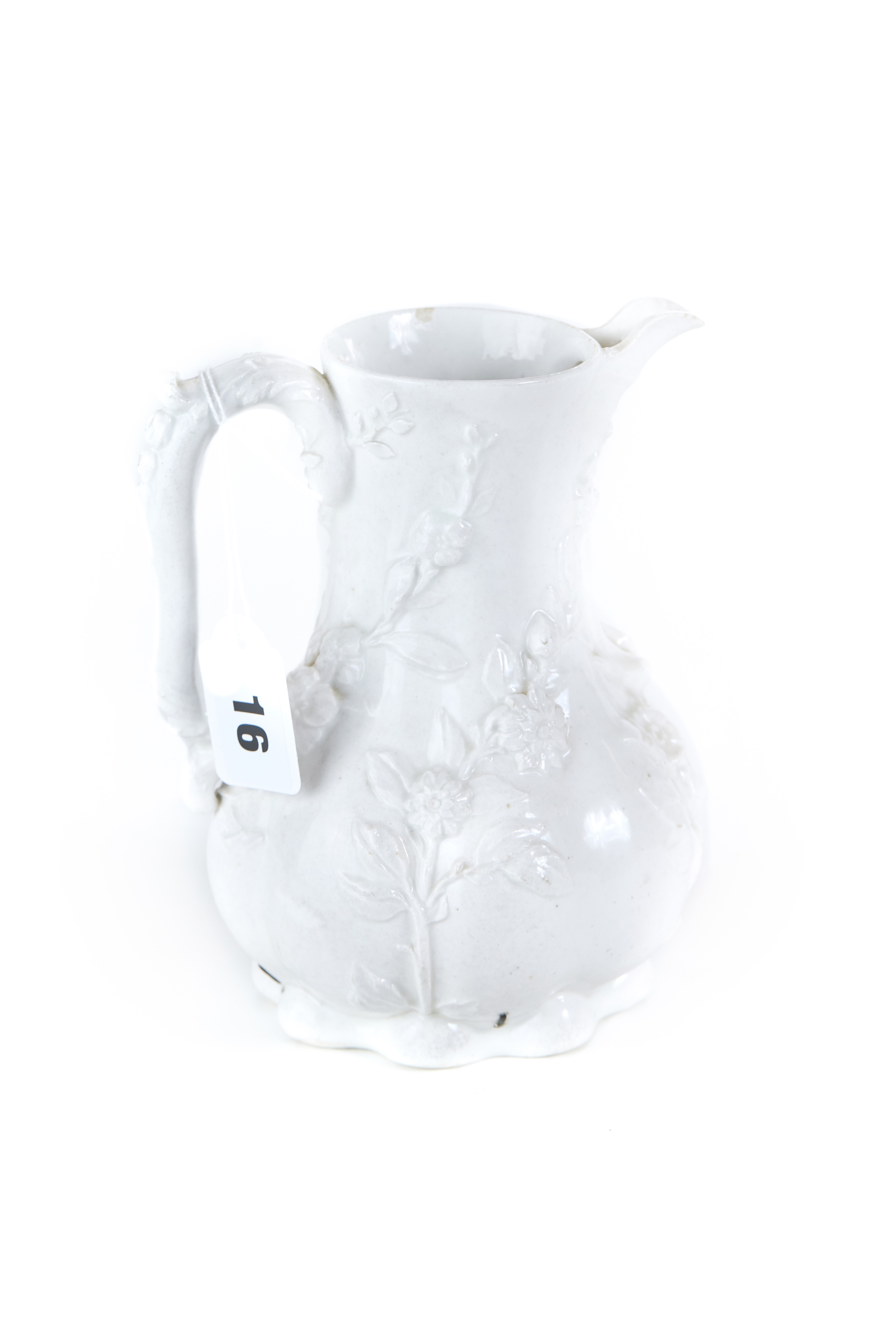 AN 18TH CENTURY CHELSEA WHITE GLAZED PORCELAIN COFFEE POT with raised moulded floral decoration and