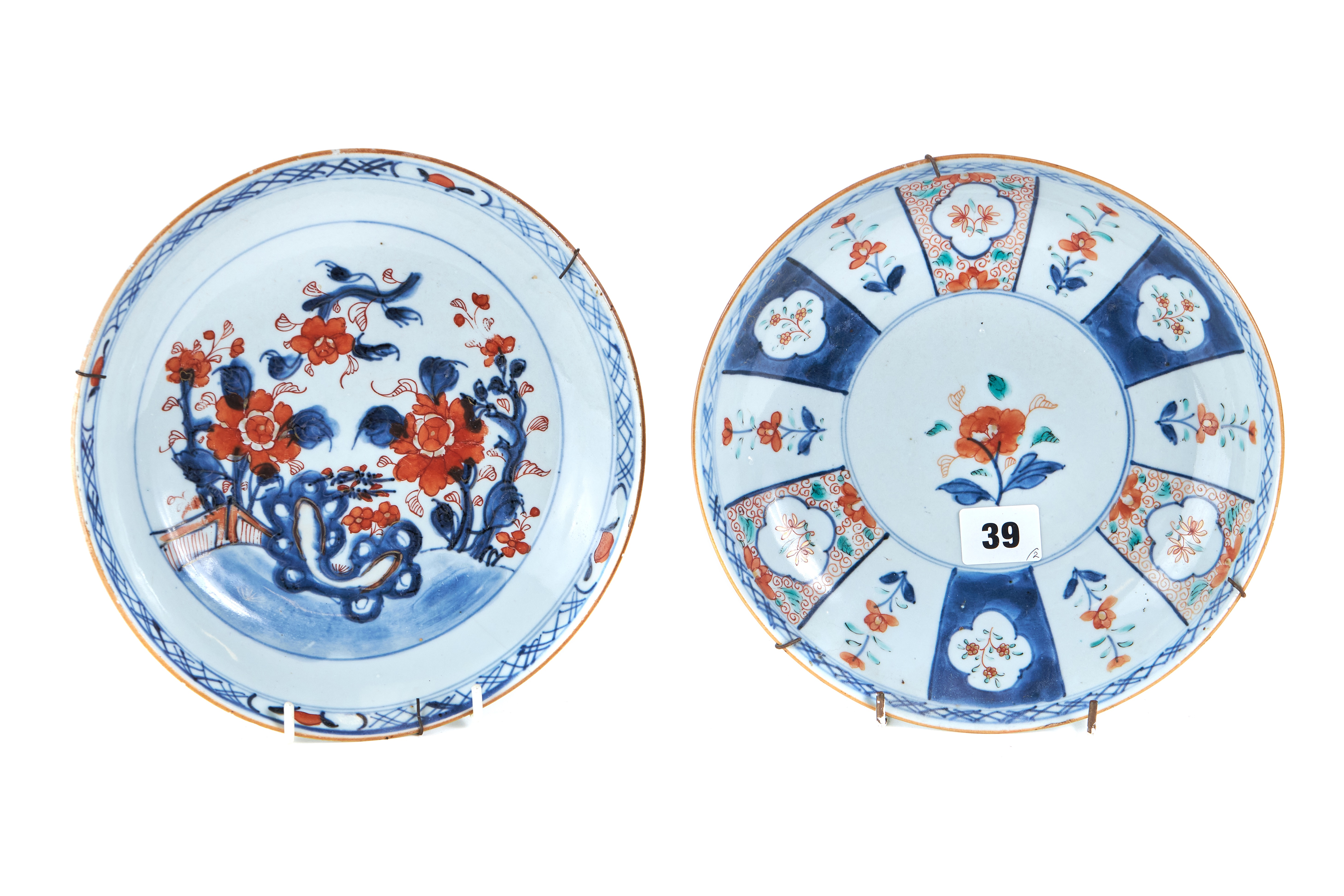 Lot 39 - AN 18TH CENTURY CHINESE PORCELAIN DISHED PLATE, decorated with polychrome panels of flowers,