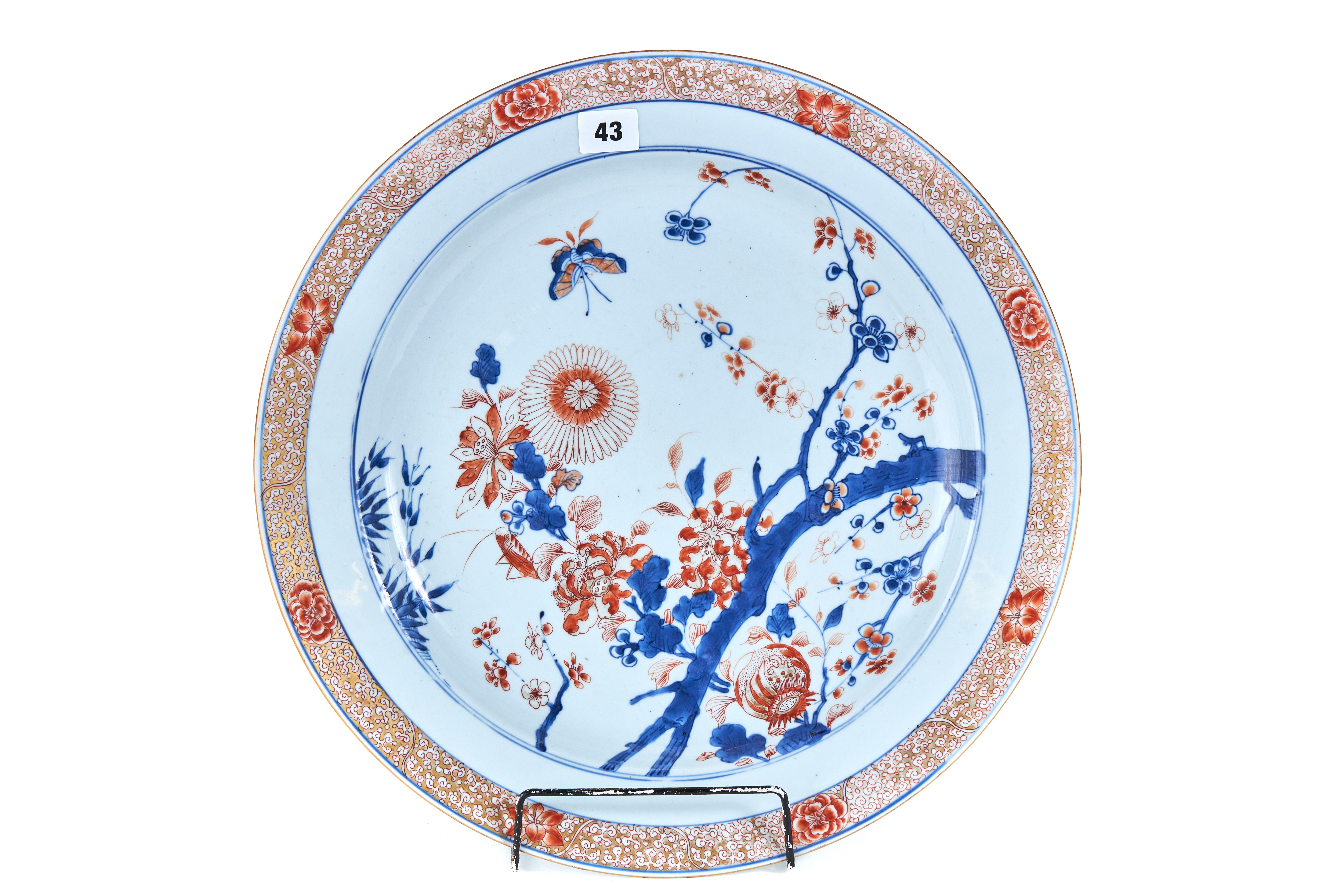 AN UNUSUAL 18TH CENTURY CHINESE IMARI PORCELAIN CHARGER decorated with flowering branches,