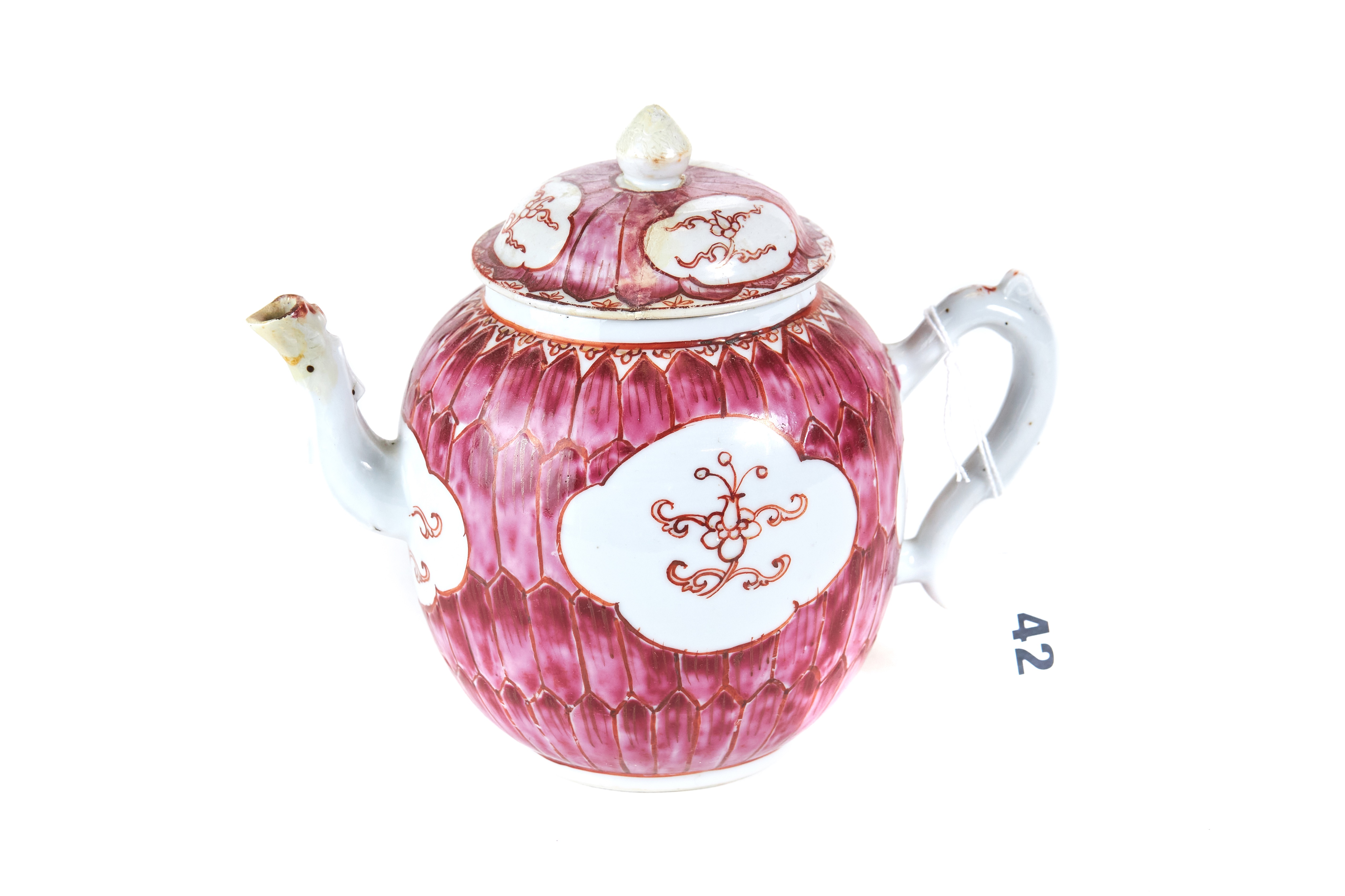 AN 18TH CENTURY CHINESE PORCELAIN TEAPOT AND COVER, pink ground with panels of flowers, 6 ins high,