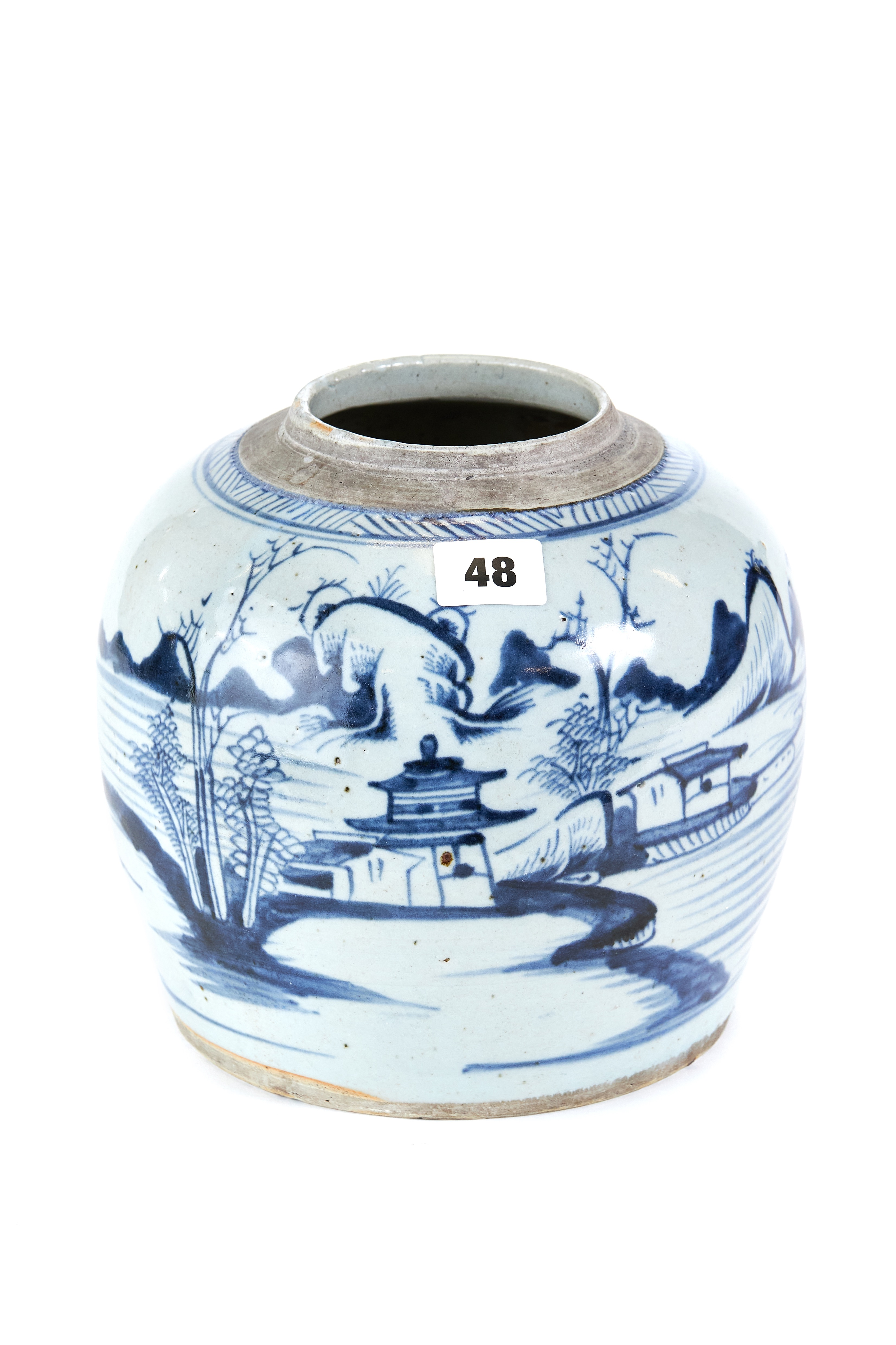 AN 18TH/19TH CENTURY CHINESE BLUE AND WHITE PORCELAIN GINGER JAR decorated with a pagoda and