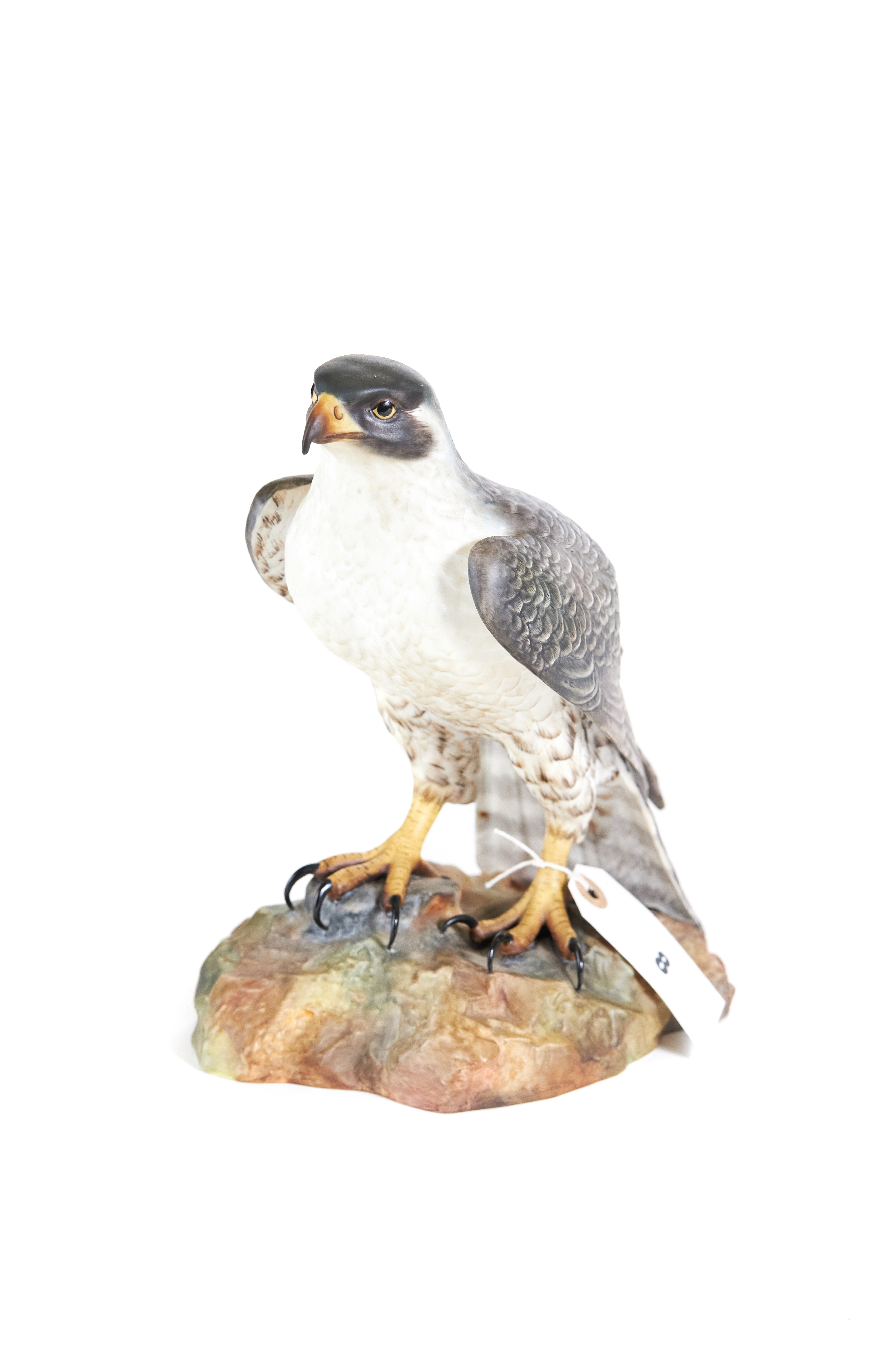 A 20TH CENTURY ROYAL CROWN DERBY MODEL OF A FALCON, on a rocky base, signed L.