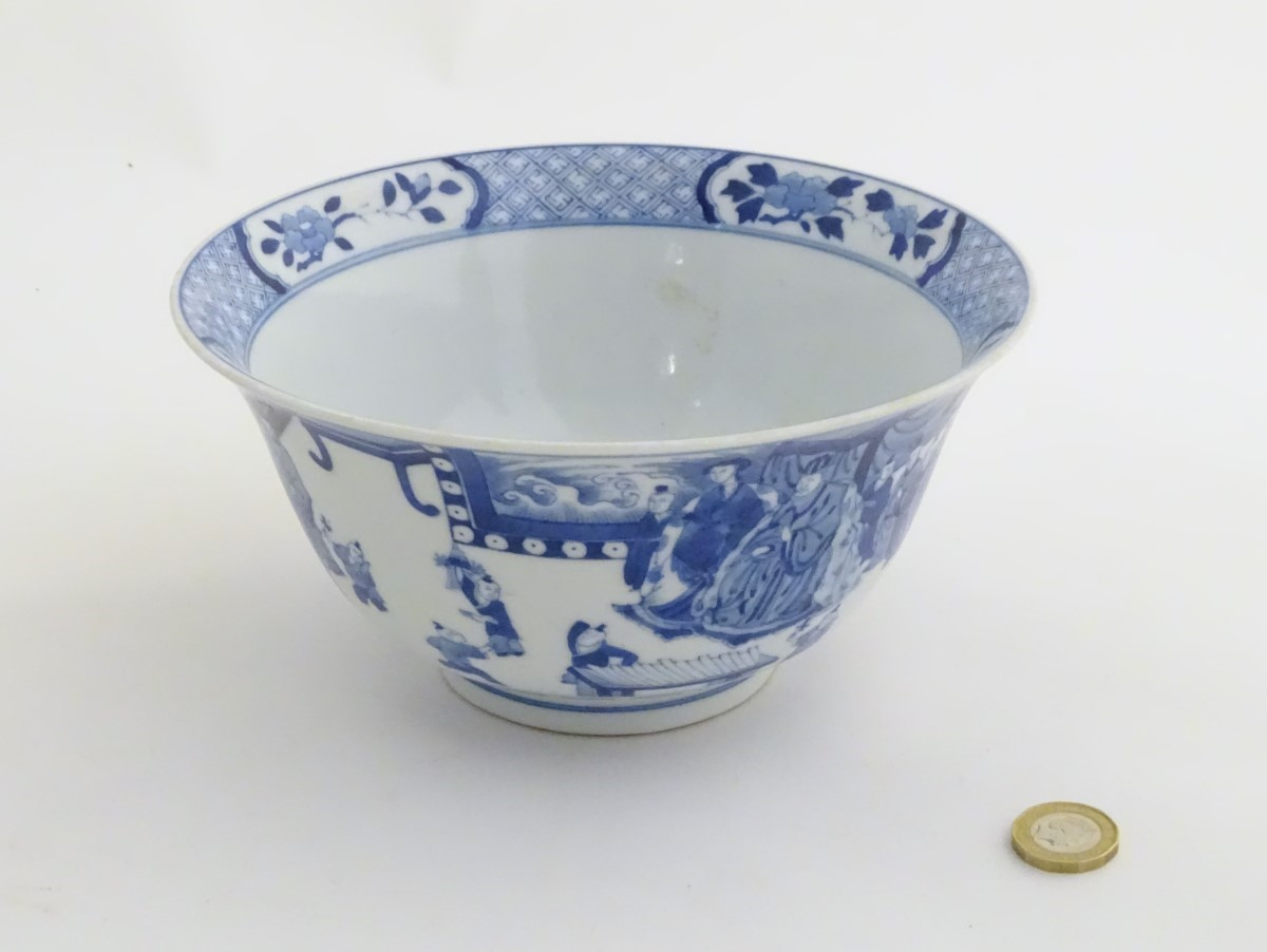 Lot 7 - A Chinese blue and white footed bowl with a flared rim,