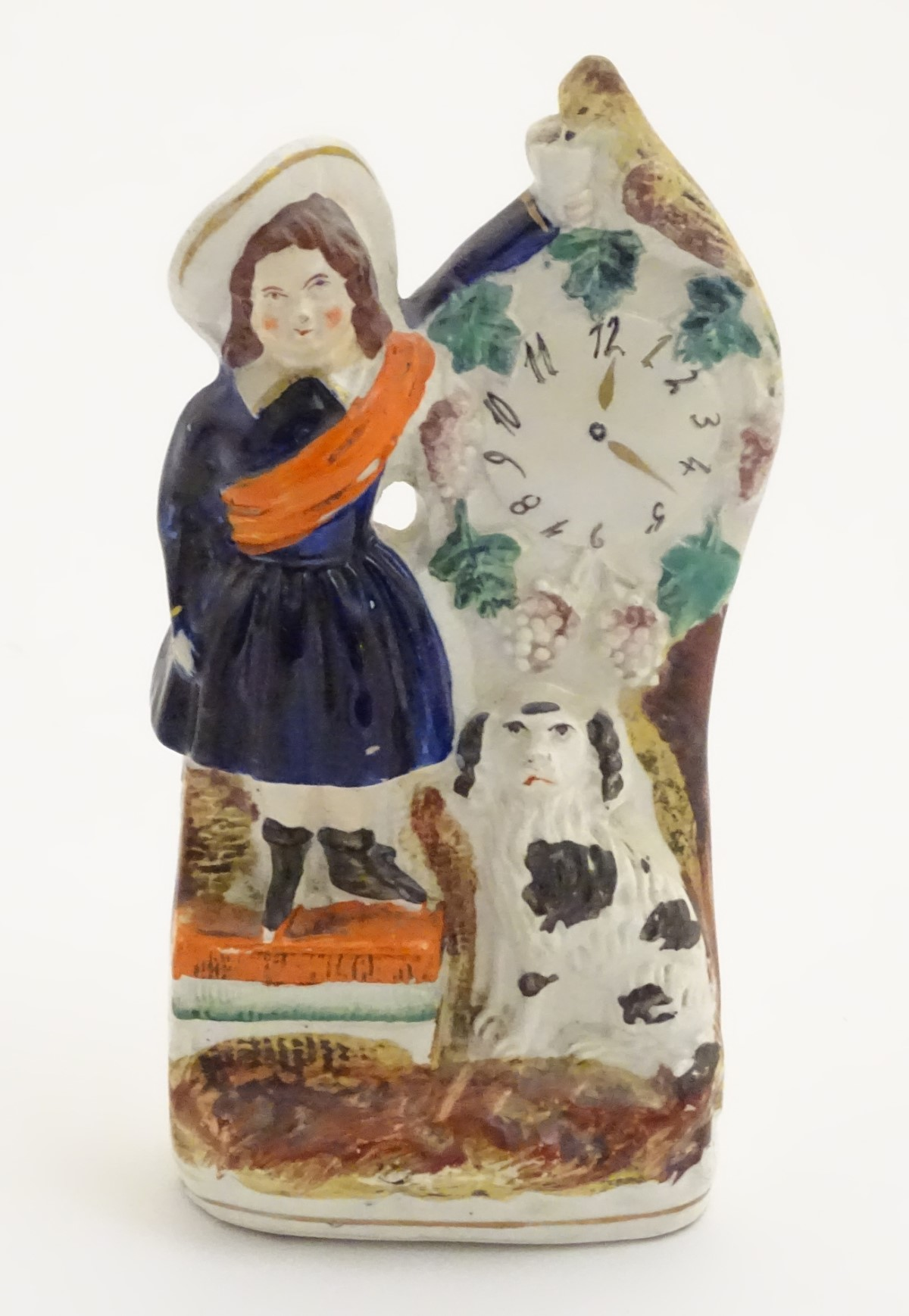 Lot 39 - A Victorian Staffordshire pottery flatback model of a woman wearing a sash feeding a bird next to a