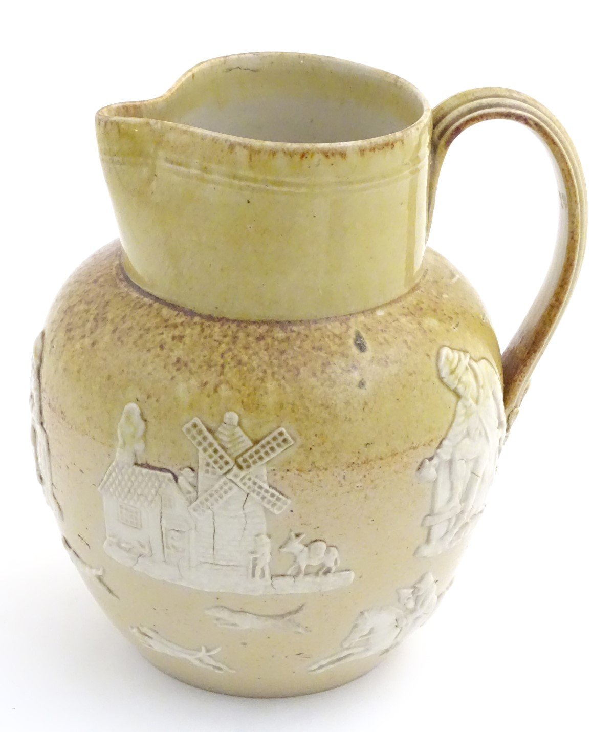 Lot 58 - A Royal Doulton salt glaze jug with relief decoration of harvest and hunting scenes,