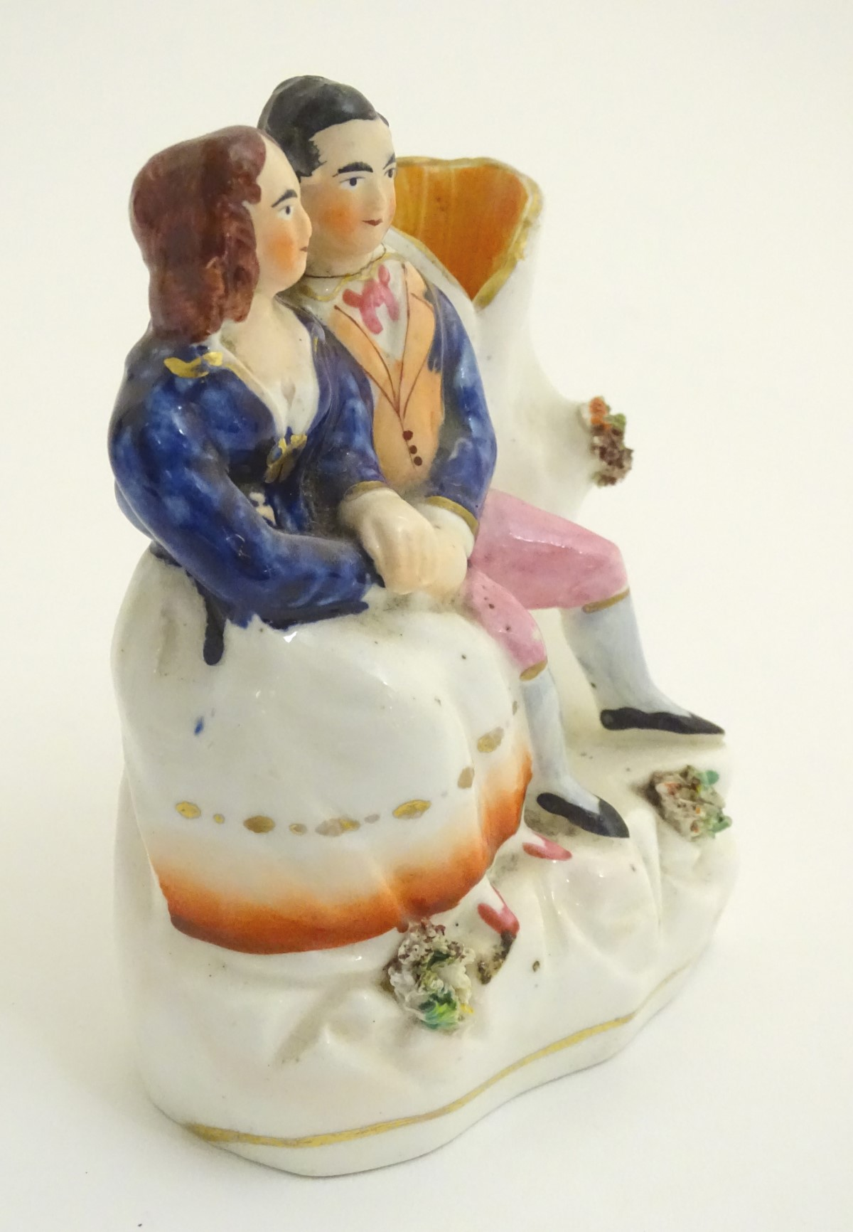 Lot 40 - A Victorian Staffordshire pottery flatback spill vase depicting Victoria and Albert seated. Approx.