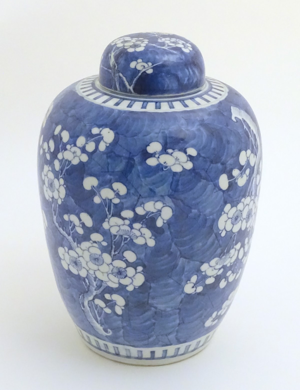 Lot 25 - A Chinese blue and white ginger jar and cover with prunus blossom decoration.