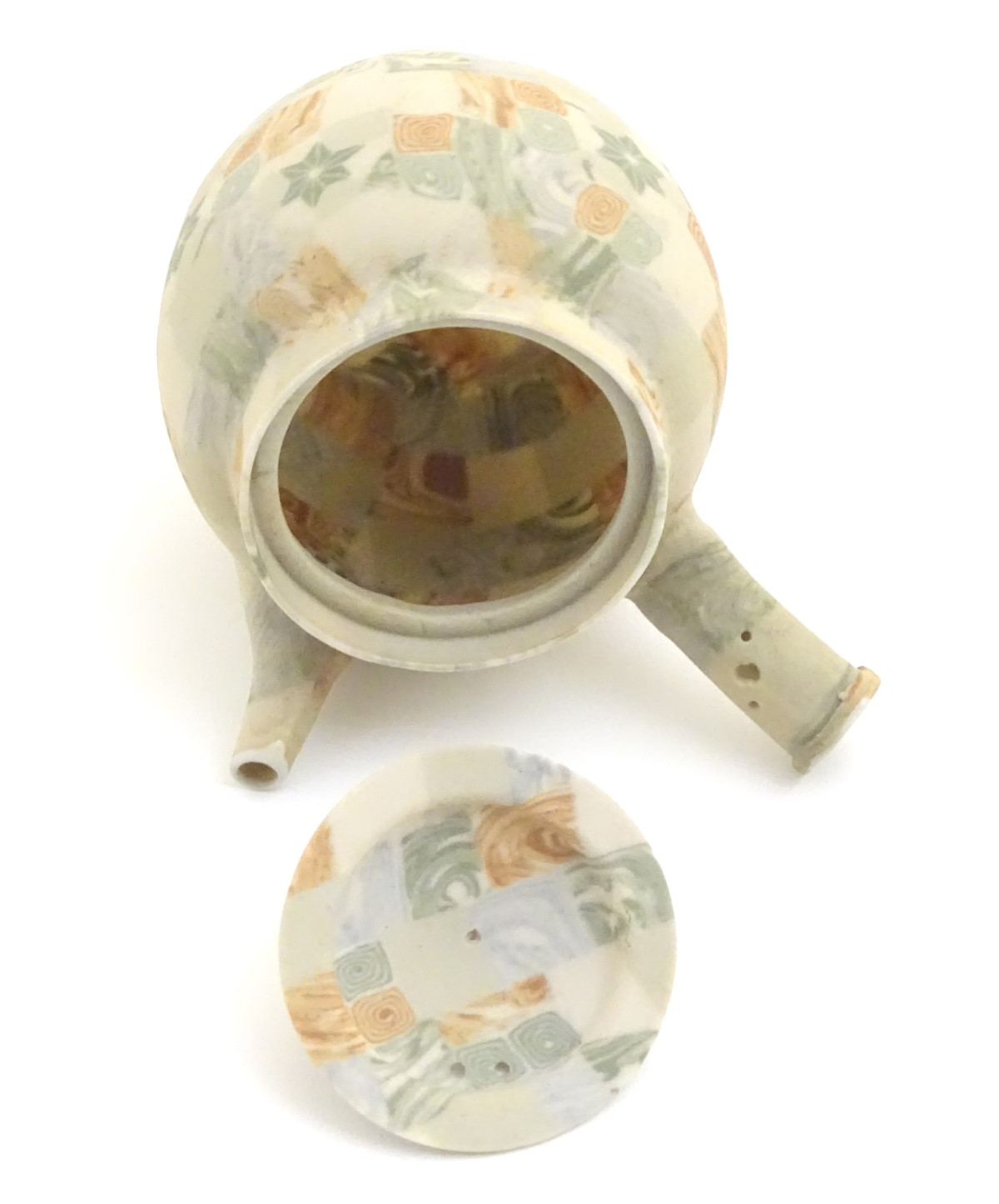 Lot 34 - A Japanese banko nerikomi / neriage / agateware teapot with spout and pouring handle,