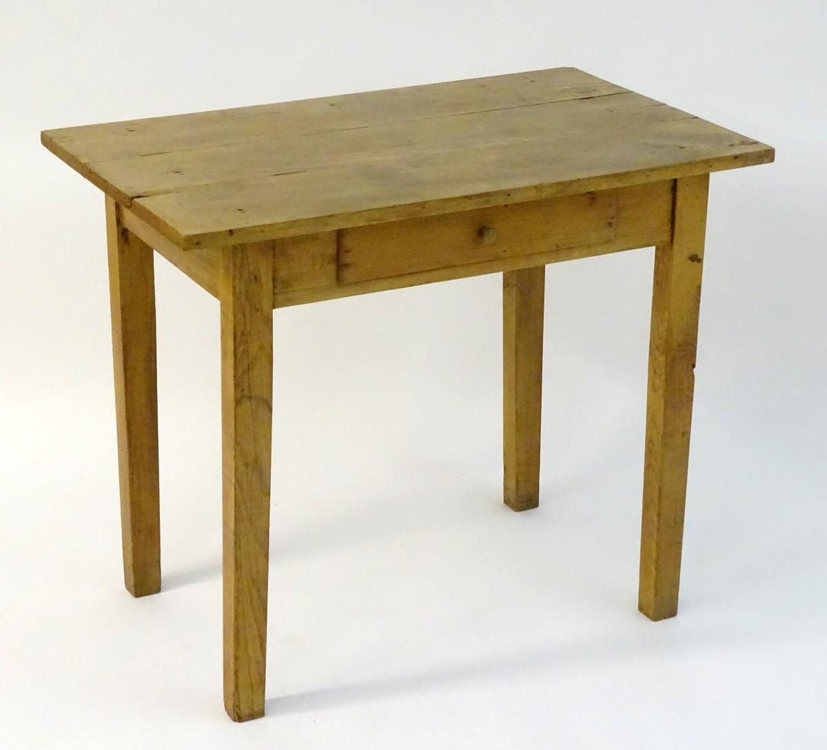 Lot 848 - A late 19thC chestnut side table / writing table with a three plank top above a single frieze
