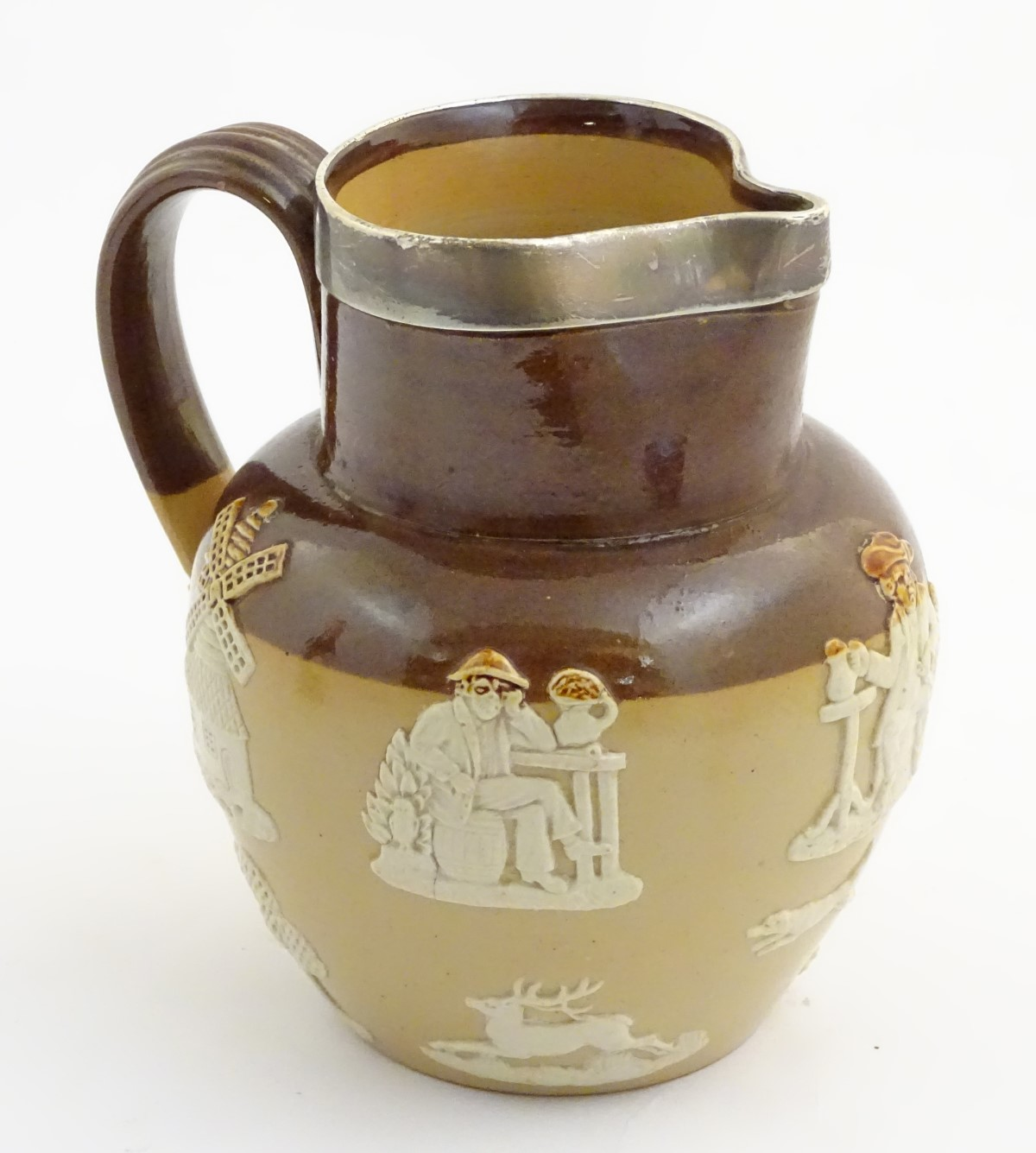 Lot 59 - A Royal Doulton two tone salt glaze jug with hallmarked silver rim, Chester 1905,