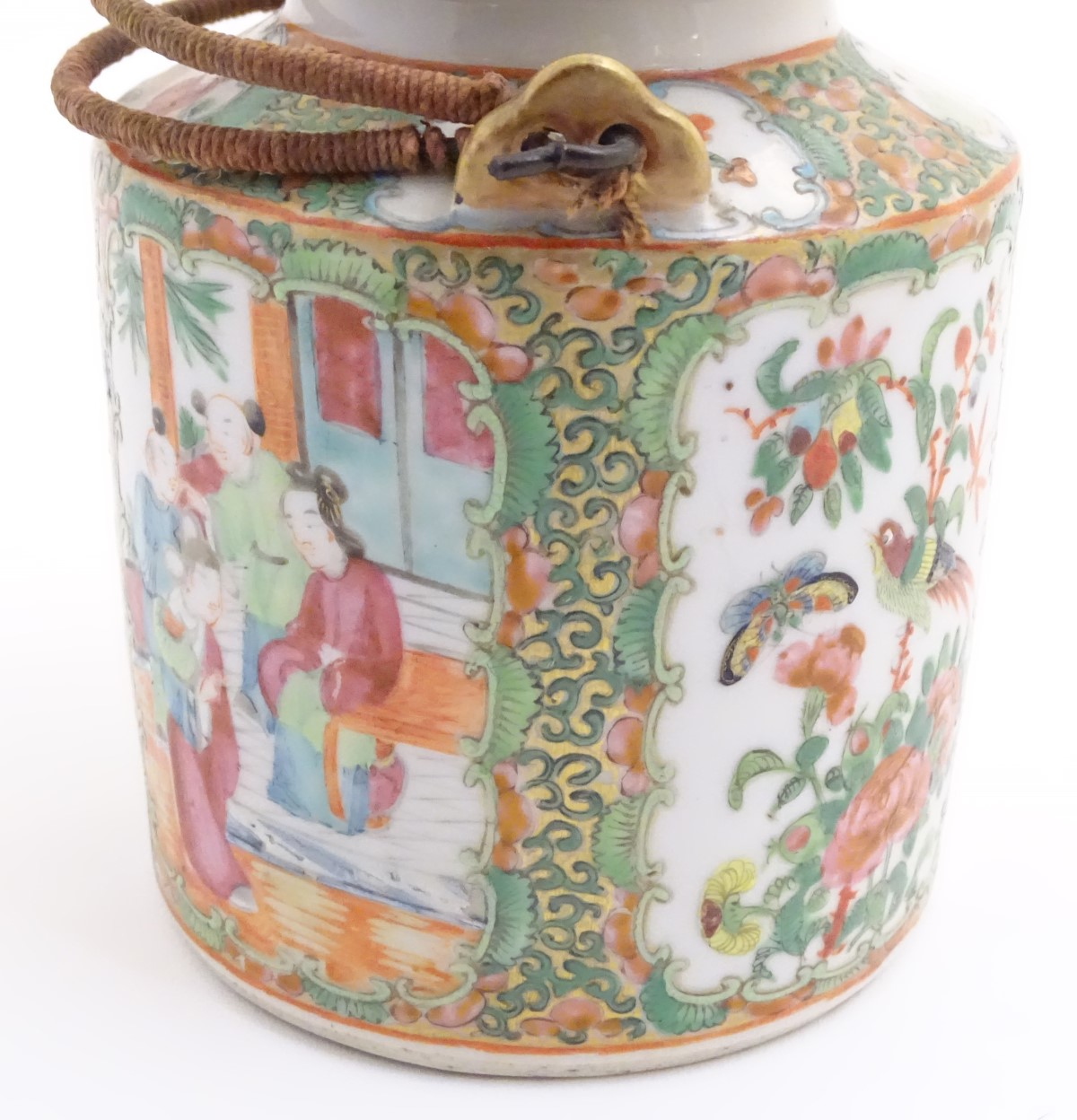 Lot 29 - A Cantonese famille verte teapot with panelled decoration depicting flowers, butterflies and birds,