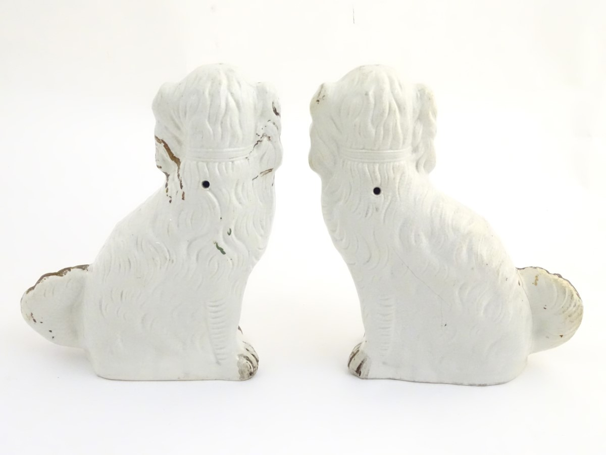 Lot 43 - A pair of large Staffordshire flat back spaniel dogs, with gilt chain collar detail.