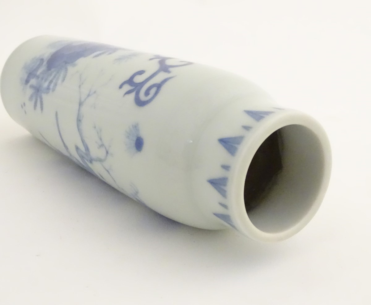 Lot 10 - A Chinese blue and white vase of narrow form, depicting figures in a stylised landscape. Approx.
