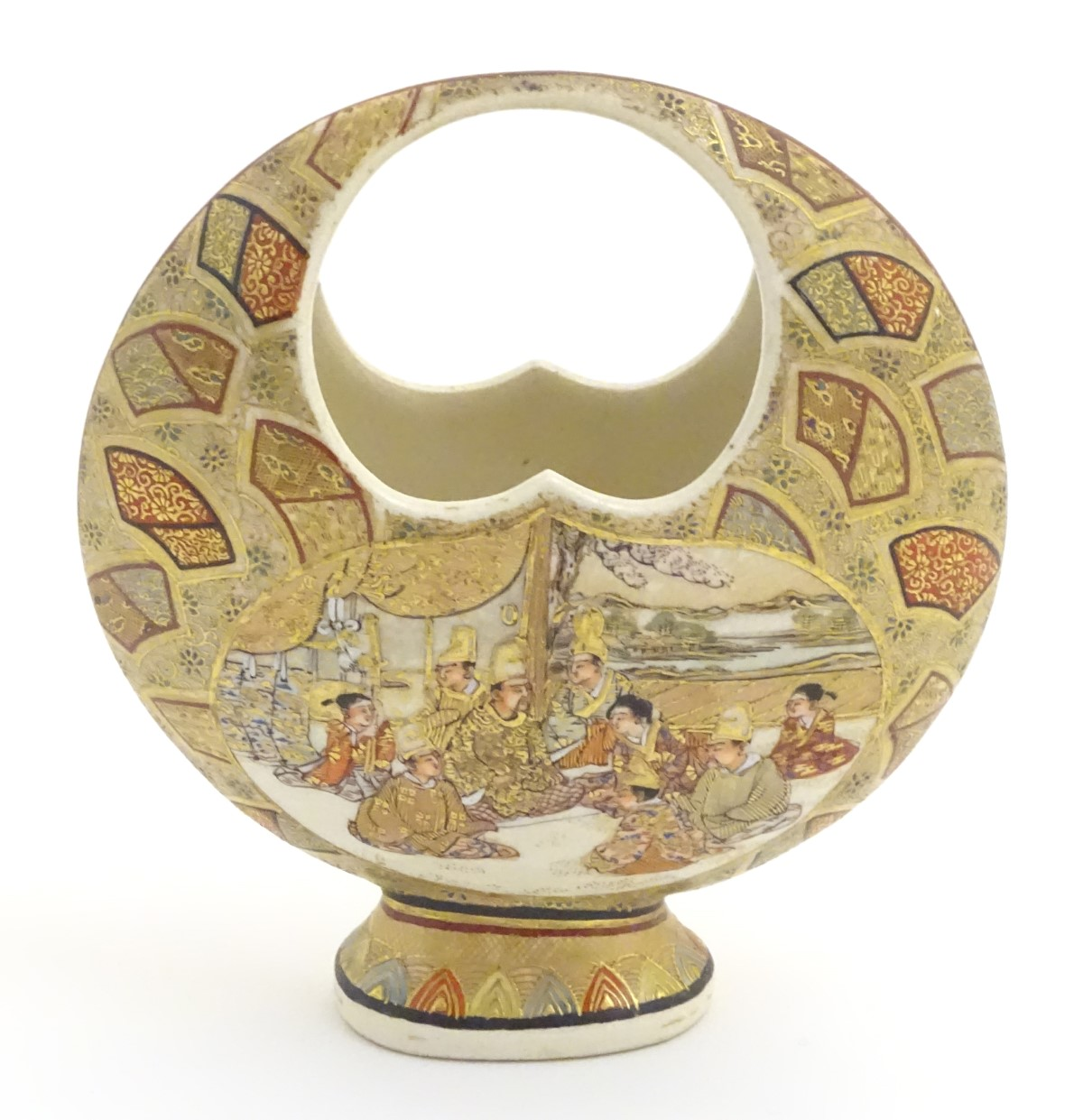 Lot 22 - A Japanese satsuma moon basket vase with hand painted decoration depicting figures seated around