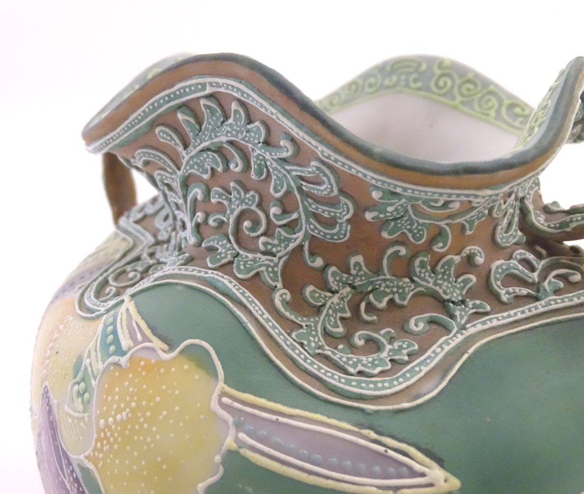 Lot 44 - A pair of Continental twin handled vases of squat form with lobed rims and hand painted floral and