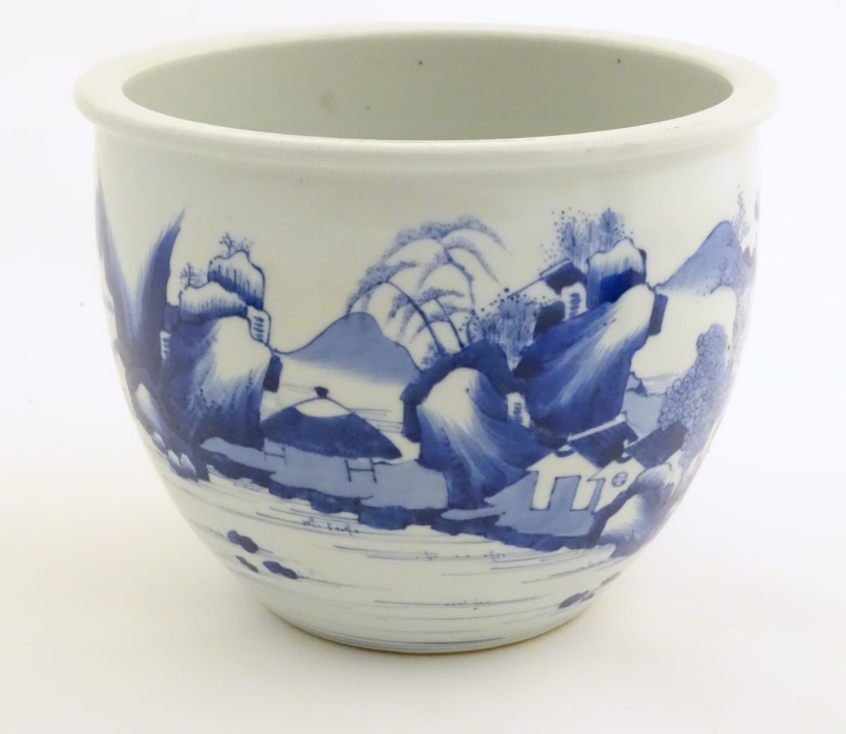 Lot 4 - A Chinese blue and white jardiniere decorated with a mountainous landscape scene with figures,