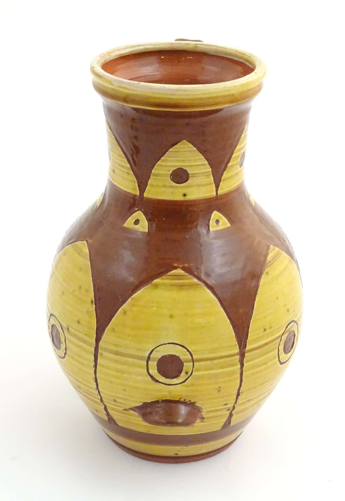 Lot 50 - A large earthenware studio pottery baluster vase / jug with single handle,
