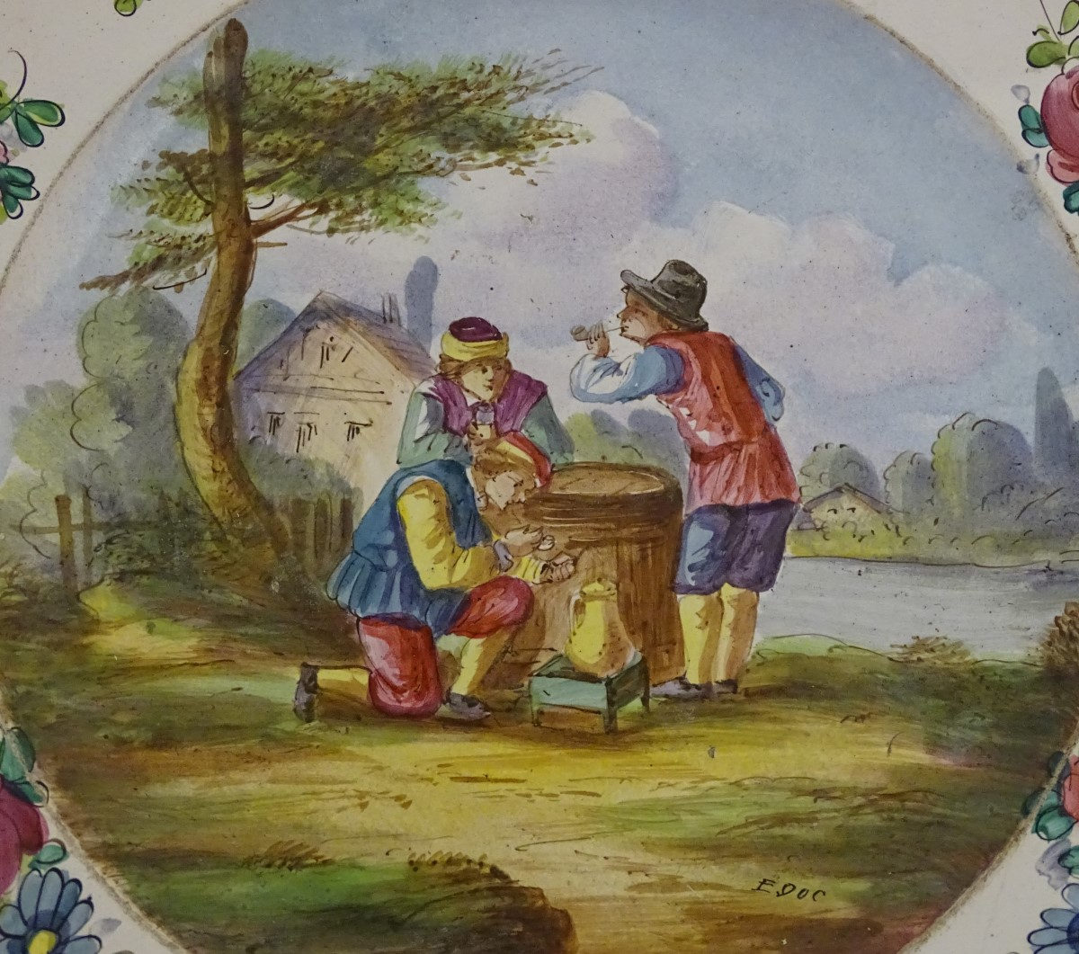 Lot 38 - Two French faience plates.