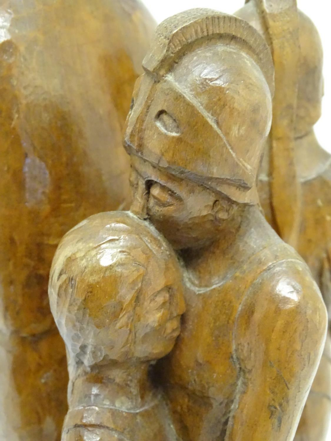 Lot 889 - A 20thC carved wooden sculpture titled Tragic Muse to base, monogrammed TD and dated 1971 to side.