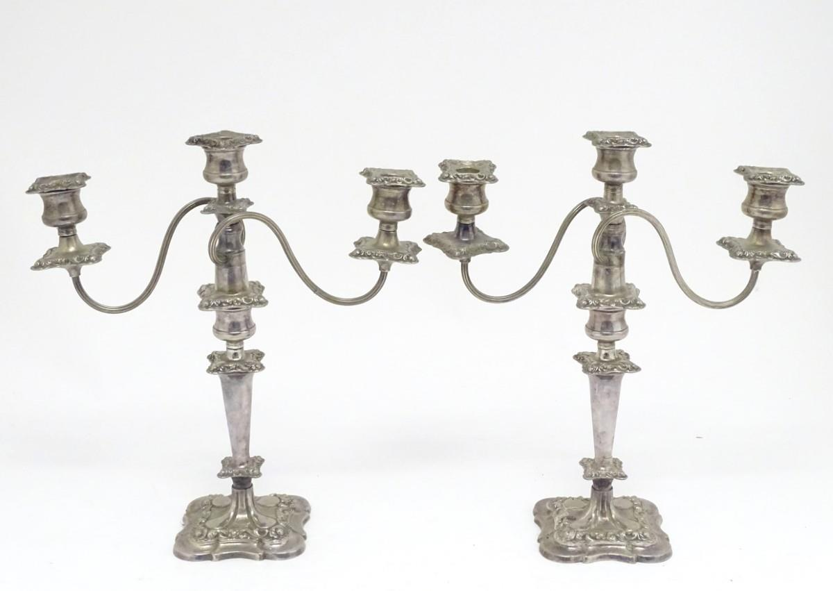 """Lot 890 - A pair of silver plate three branch table candelabra / candelabrum. Approx. 16 1/2"""" high. (2) Please"""