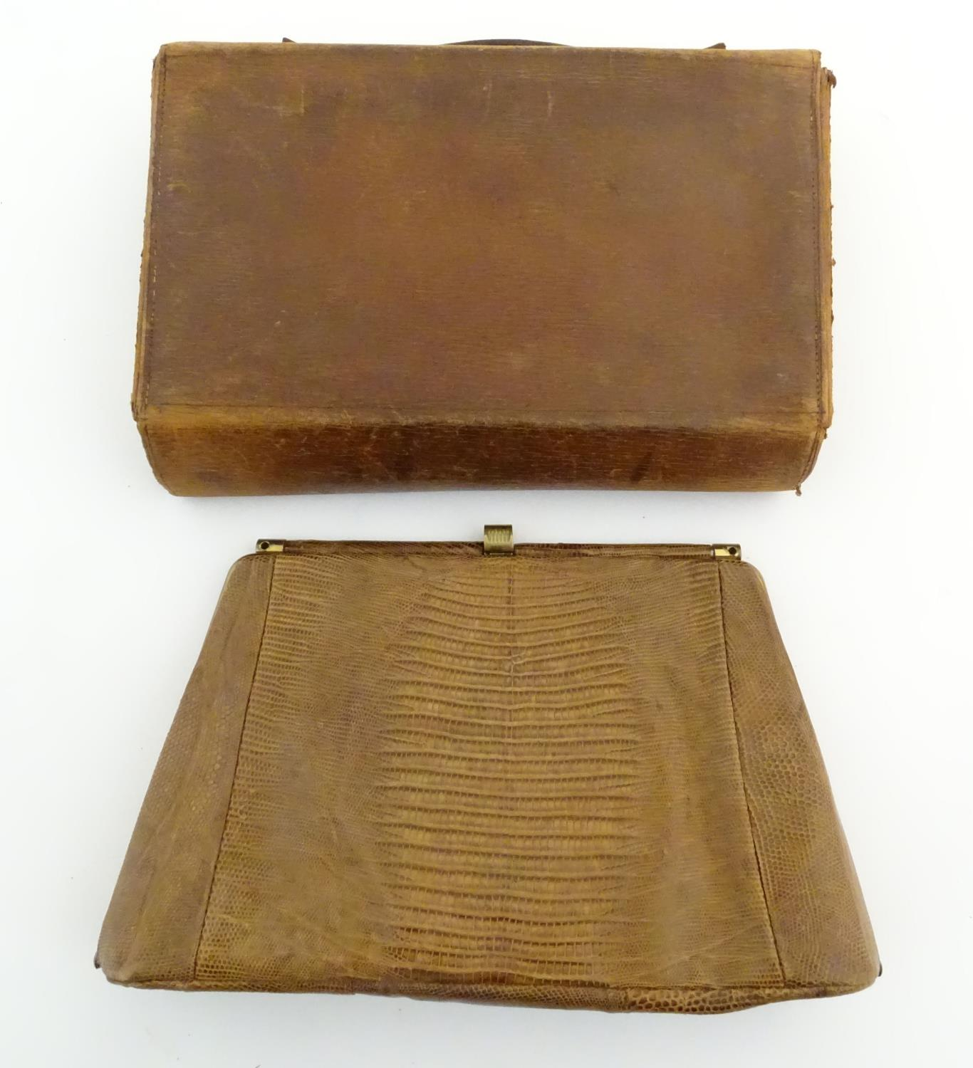 Lot 739 - A late 19thC / early 20thC pig skin travelling vanity case of satchel form with blue leather lining,