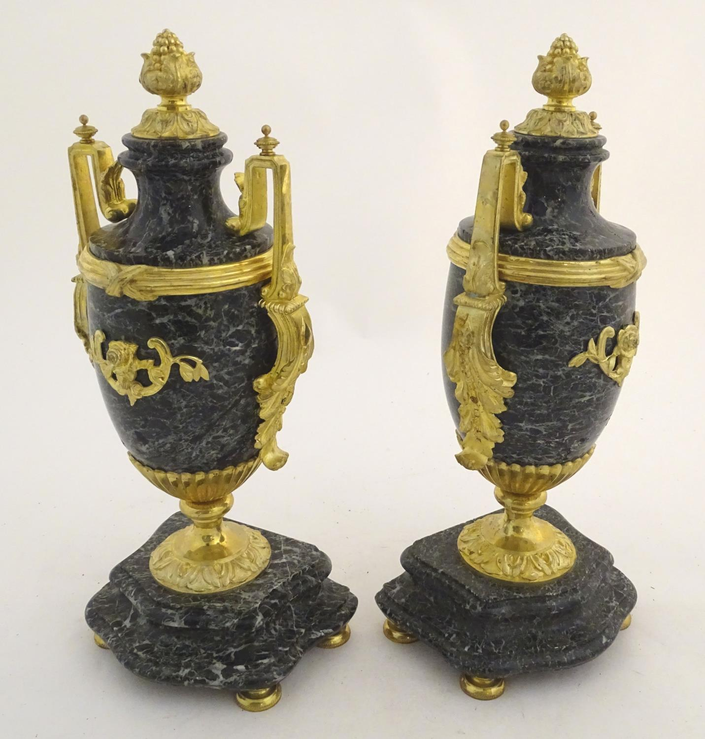 Lot 887 - A pair of late 19thC grey marble garnitures of urn form with gilt metal handles and mounts.