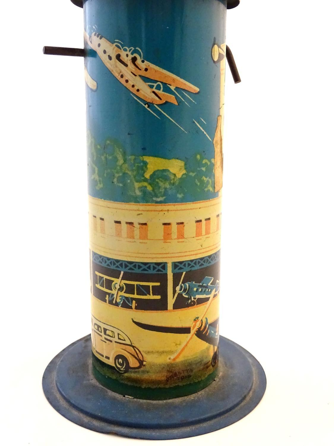 "Lot 527 - Toys: An early 20thC tin plate Tower Aeroplane / airplane by Louis Marx & Co. Approx. 8 1/2"" high."