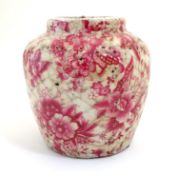 A Continental squat vase with a pink flower and foliate detail and a crackle glaze. Approx. 5 3/4""