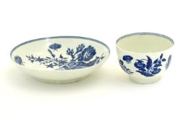 A Worcester blue and white cup and saucer in the pattern Three Flowers. Marked under with crescent