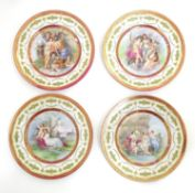 Four Royal Vienna plates depicting mythological figures to include Cupid and Psyche, Neptune and
